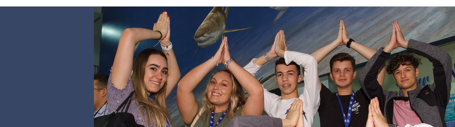 students with fins up